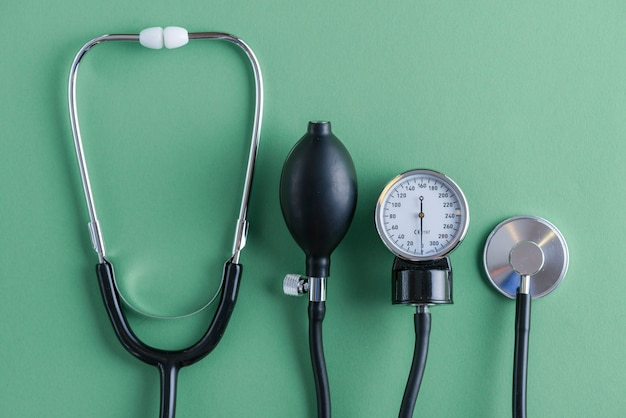 Stethoscope lying near sphygmomanometer