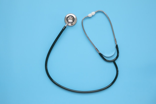 Stethoscope medical equipment on blue background healthcare concept