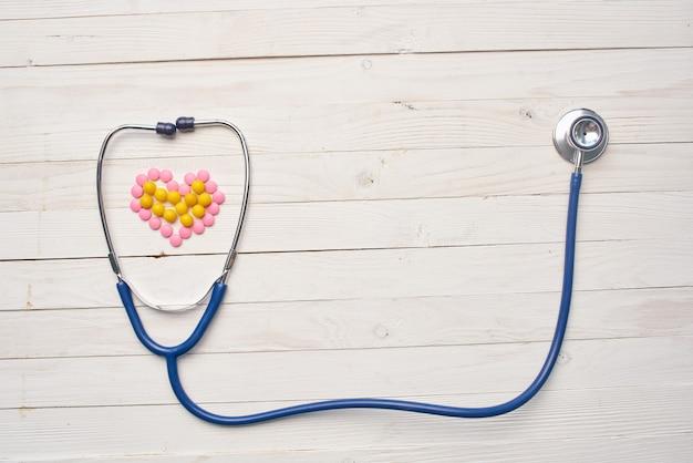 Stethoscope medicine hospital pills wooden background