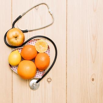 Stethoscope near fruits