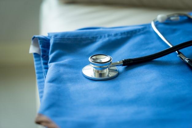 Stethoscope on nurse & doctor coat background