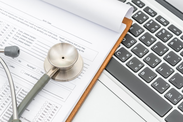 Stethoscope and prescription on laptop