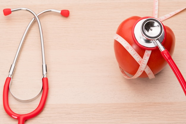 Stethoscope and red tomato, healthcare, medicine and insurance