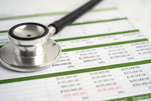 Stethoscope on spreadsheet paper finance account statistics investment
