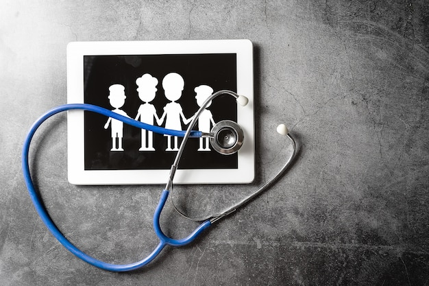 Stethoscope and tablet on floor, healthy concept