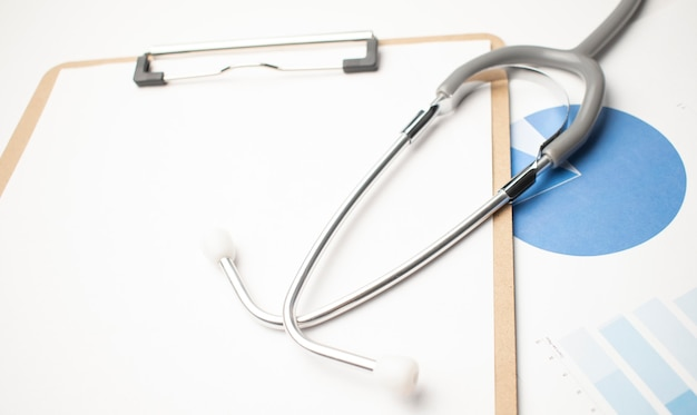 Stethoscope with blue charts on the white background