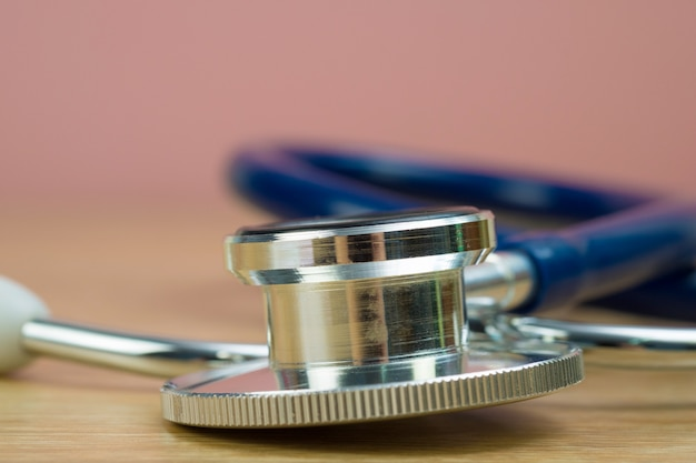 Stethoscope with blue tube on table, health and medical concept.