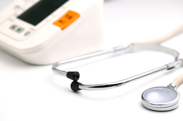 Stethoscope with electronic blood pressure monitor or sphygmomanometer on the white background. healthcare concept.