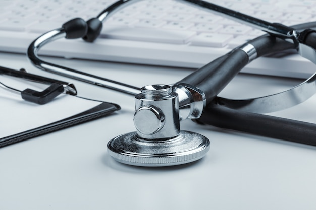 Stethoscope with laptop on the table