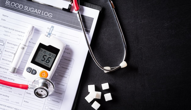 Stethoscope with patient's blood sugar control chart. world diabetes day, 14 november.