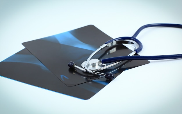 Stethoscope and x-rays on a white background.the concept of health