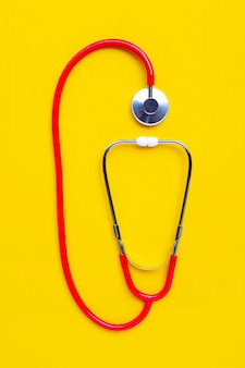 Stethoscope on yellow background. copy space