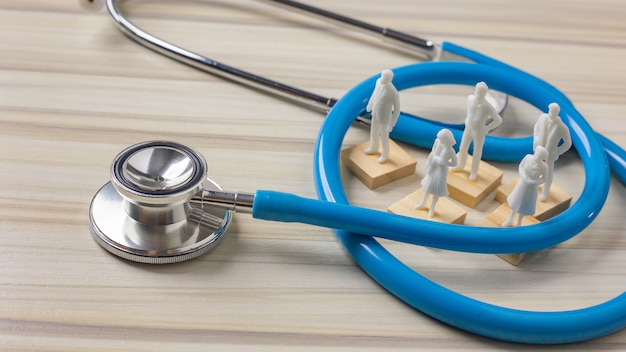 Stethoscopes on wood background image close up