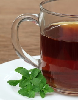 Stevia with cup of tea on table