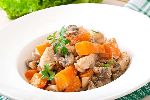 Stew chicken with vegetables and mushrooms in a cream sauce
