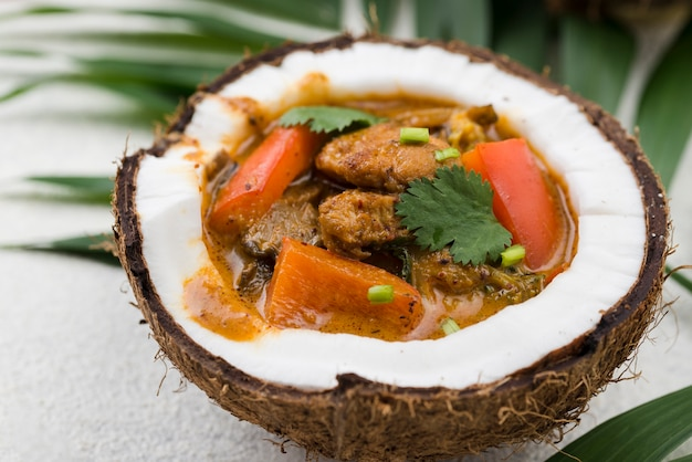 Stew in coconut plate close-up