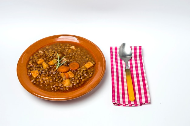 Stew of lentils with chorizo and pork.isolated
