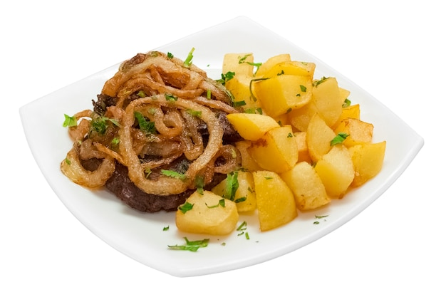 Stew with juicy beef potatoes rustic golden onion rings and spices roasted in the oven