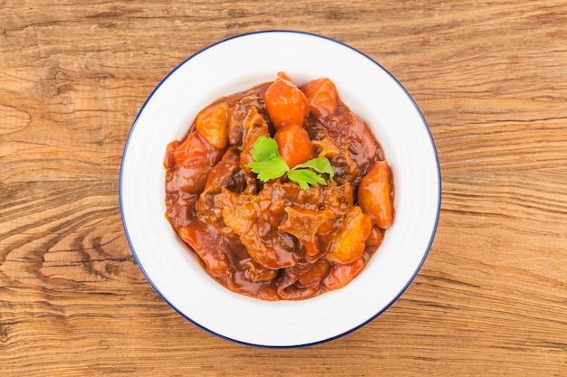 Stewed beef tail with carrots and potatoes