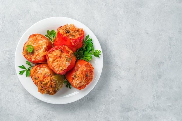 Stewed bell pepper with turkey rice and vegetables on a gray background