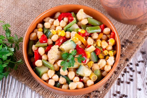 Stewed chickpea with vegetables. vegetarian dish. selective focus