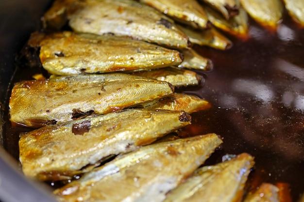 Stewed mackerel fish in salty soup