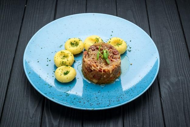 Stewed sauerkraut with sausage on a plate