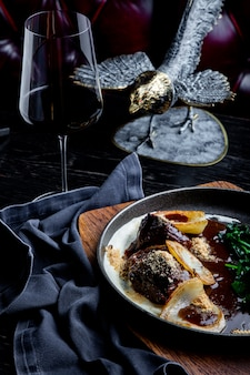 Stewed veal cheeks in red wine, served with mashed potato.  for menu.