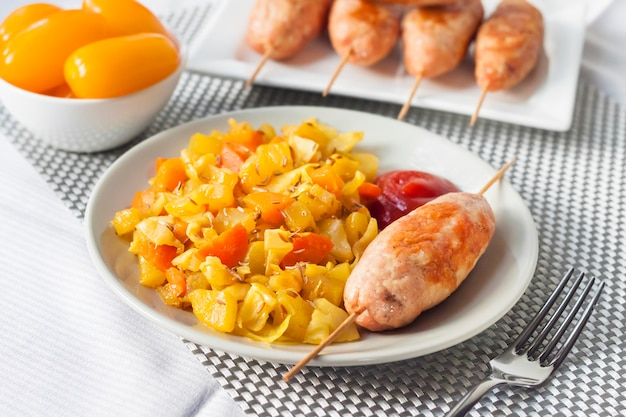 Stewed vegetables with turmeric and cumin and turkey kebab