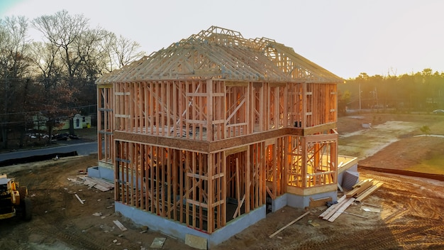 A stick built house under construction new build with wooden and beam framework.
