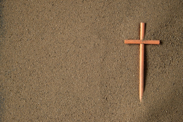 Stick cross on the sand death funeral israel war warrior