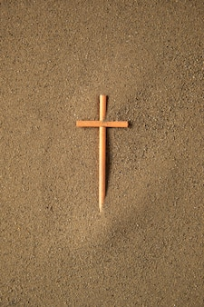 Stick cross on the sand