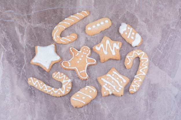 Stick, star and ovale shape gingerbread cookies on the marble