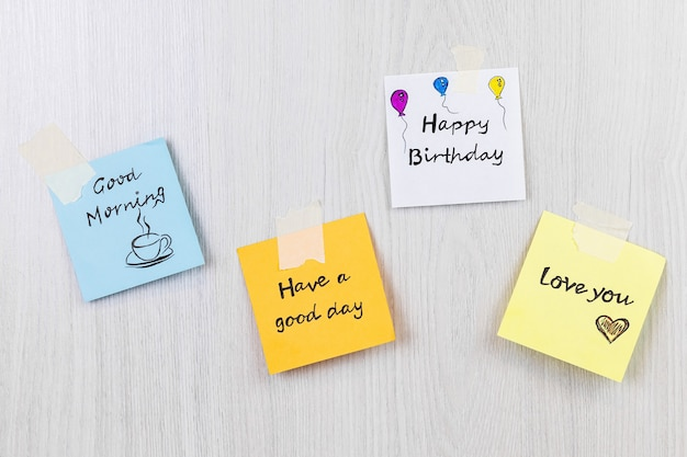 Stickers with the inscription on colored paper love you happy birthday have a good day