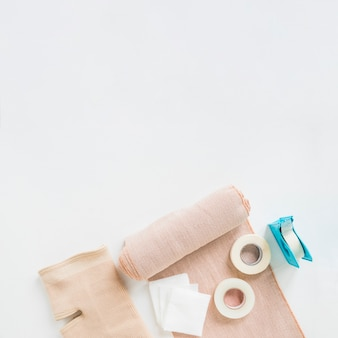 Sticking plaster; medical bandage and knee brace on white background