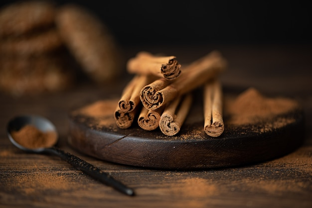 Sticks and cinnamon powder on a board