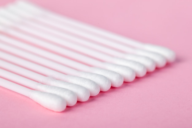 Sticks for cleaning ears on a pink