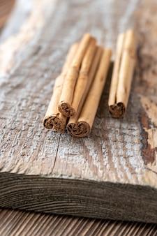 Sticks of true cinnamon on the wooden table