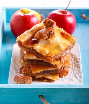 Sticky apple and caramel slices on plate