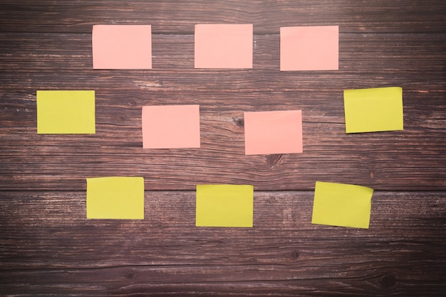 Sticky note blank space on the wooden board backgrounds