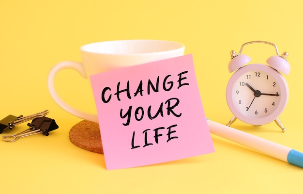 Sticky note with change your life message
