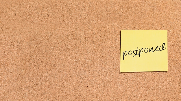 Sticky note with postponed message