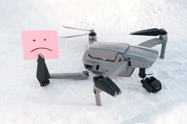 Sticky note with sorry smile in drone propeller blades.