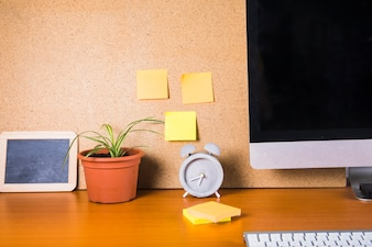 Sticky notes and table decorations near monitor