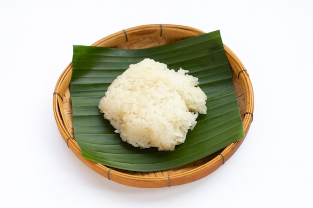 Sticky rice in bamboo basket on white background.