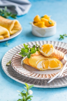 Sticky rice and mango crepe cake roll ,  hong kong , thai food style in summer