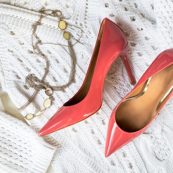 Stiletto shoes or high heels and white sweater