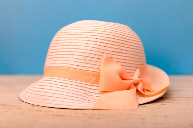 Stilish summer straw hat for women on blue