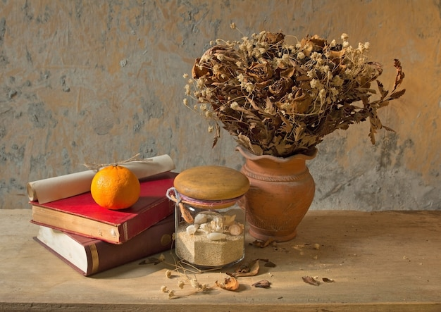 Still life apple fruit and old book with seashell decoration