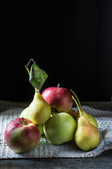 Still life of apples and pears on the table. autumn mood.